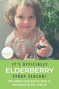 Maeve holding Spiced Elderberry Syrup by Sarah McLachlan, Naturopath, Akeso Health